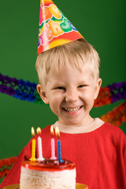 stock photo of birthday hat  - A happy boy on his birthday making a wish - JPG