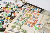 Постер, плакат: Альбом для марок с почтовых марок