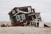 MANTOLOKING, NJ - JAN 13: A tilted home off its foundation on the beach on January 13, 2013 in Manto