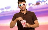 image of matinee  - Man Eating Popcorn And Watching 3d Movie - JPG