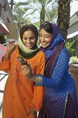 picture of dupatta  - Happy Indian female friends in traditional clothes taking self portrait - JPG