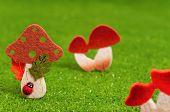 pic of shroom  - Artificial small mushrooms on artificial green grass - JPG