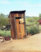 stock photo of outhouses  - Old western style outhouse in a ghost town - JPG