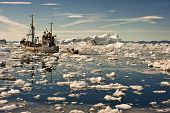 image of ski boat  - Fishing boat going through the icy waters at the sunset of Ilulissat - JPG