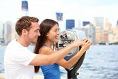 Tourists couple travel in New York. Beautiful young interracial young couple on travel looking at Ma