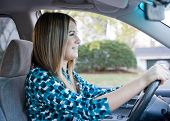 foto of driving school  - Teenage Girl Happy to Be Driving at Last - JPG