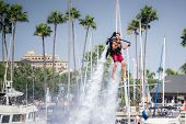 Unidentfied man demonstrates flyboard acrobatics in Long Beach