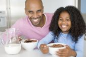 pic of eat me  - fatherdadeatingBreakfast Cereal Child Daughter Father Happy Kitchen 40s 9 Year Old African American Bowl Color Colour Cutlery Domestic Domestic Life Eating Elementary Age Enjoying Food Forties Holding Home Horizontal Image Indoors Looking At Camera Man me - JPG