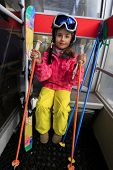Ski, ski cable car, skier, ski resort - happy girl in cable car