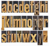 complete English lowercase alphabet - a collage of 26 isolated antique wood letterpress printing blo