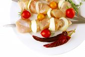 served chicken shish kebab on white platter