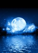 stock photo of blue moon  - A romantic blue moon on a starry background with room for text to be dropped in - JPG