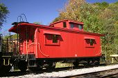 pic of caboose  - A vintage wooden red caboose on a track - JPG