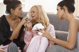 image of nighties  - Female friends comforting crying girl at home - JPG