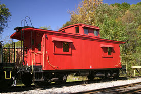 picture of caboose  - A vintage wooden red caboose on a track - JPG