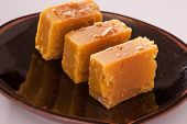 pic of ghee  - Mysore Pak is a Sweet dish made from gram flour - JPG