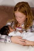 picture of niece  - young girl is holding her 3 weeks old baby niece - JPG