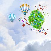Sunny image with balloons and aerostat flying in blue sky
