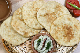 picture of urad  - Urad dal puri Indian flatbread which is made with wheat flour served as breakfast dish - JPG