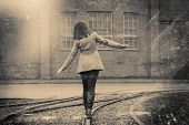 picture of children walking  - girl walking on the railway retro stylized in black and white colors photo - JPG
