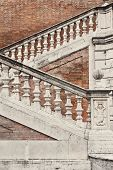 stock photo of balustrade  - Staircase with a balustrade in old house  - JPG