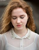 stock photo of button down shirt  - Portrait of a beautiful ginger teenage girl wearing a white see - JPG
