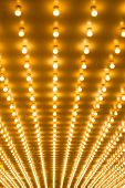stock photo of broadway  - golden bulbs marquee lights background - JPG