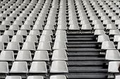 stock photo of tribunal  - Tribune sports stadium gray chairs arranged in rows - JPG