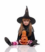 pic of warlock  - Little girl in black hat with pumpkin sitting on floor - JPG