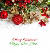 stock photo of merry christmas text  - festive christmas decorations in red and gold - JPG