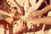 pic of multicultural  - Multicultural childrens hands in a circle - JPG