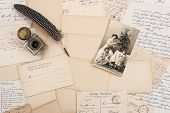 stock photo of feathers  - old letters vintage postcards and antique feather pen - JPG