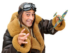 stock photo of fighter plane  - Fighter pilot with model plane isolated in white - JPG