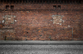 stock photo of urbanization  - Industrial background empty grunge urban street with warehouse brick wall - JPG