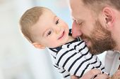 picture of daddy  - Portrait of daddy embracing baby boy - JPG