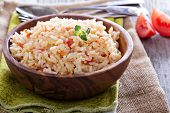 stock photo of creole  - Rice with tomatoes and onions healthy side dish - JPG