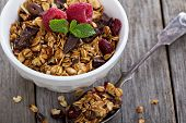 stock photo of breakfast  - Chocolate granola for breakfast with dried cranberry - JPG