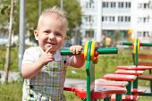 image of playground  - Cute baby boy playing on a playground - JPG