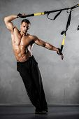 image of stretching  - Young man stretching muscles making functional training - JPG