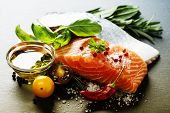 stock photo of gourmet food  - Delicious  portion of fresh salmon fillet  with aromatic herbs - JPG