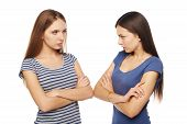 image of argument  - Two girls friends standing on white background discontent and having an argument - JPG