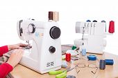 pic of sewing  - Woman seamstress work on the sewing products - JPG