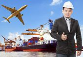 pic of export  - working man and commercial ship on port and air cargo plane flying above use for water and air transportlogistic import export industry - JPG