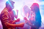 image of clubbing  - Happy young couple dancing in night club - JPG