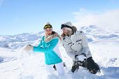 stock photo of snowball-fight  - Couple in snowy mountain doing snowballs fight - JPG