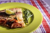 pic of pangasius  - Dish of Pangasius fillet with rosemary and lime on plate and fabric background - JPG