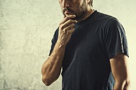 stock photo of cognitive  - Forgetful Man Having Problems Remembering Something Important Hand on Chin - JPG