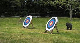 stock photo of archery  - Outdoor archery target boards with archery arrows - JPG
