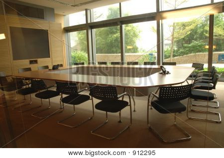 Picture or Photo of Boardroom with display screen and video conference equipment