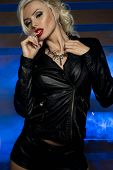image of voluptuous lips  - Sexy beautiful blonde woman posing in lack leather clothes - JPG